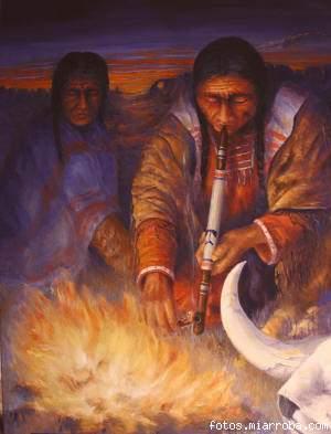 Indios fumando la pipa de la paz